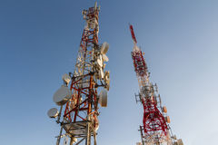 Telecommunications Towers. Metal tower or turret telecommunications satellite dishes reception and emission Royalty Free Stock Photos