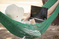 Telecommuting in a hammock Royalty Free Stock Photo