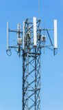 Telecomunication tower. Front of the blue sky Stock Photography