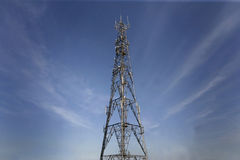 Telecomunications mast. Radio Mast with dramatic clouds behind royalty free stock images