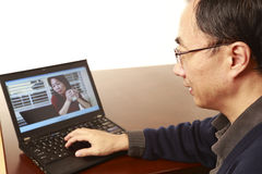 Teleconference. An Asian men having teleconference Stock Photo