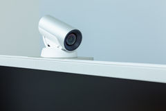 Teleconference, video conference or telepresence camera with bla. Teleconference, video conference or telepresence camera with  black screen display Royalty Free Stock Photography