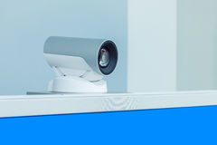 Teleconference, video conference or telepresence camera with blu. Teleconference, video conference or telepresence camera with  blue screen display Royalty Free Stock Image