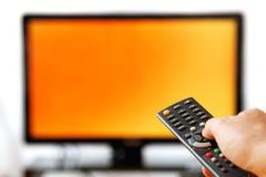 Telecontrol de la TV aislado en blanco. Foto de archivo libre de regalías