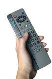 Telecontrol sostenido por la mano de la mujer imagen de archivo