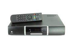 Telecontrol y receptor para la TV vía satélite Imágenes de archivo libres de regalías
