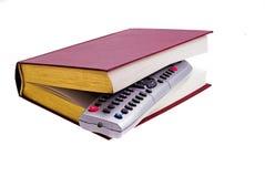 Telecontrole & livro da tevê imagem de stock