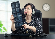 Teledoctor looking at x ray picture of brain Royalty Free Stock Photography