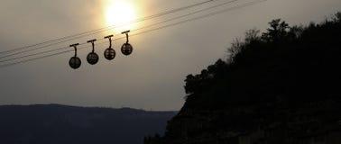 Teleféricos da esfera no por do sol Foto de Stock