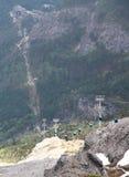 Teleféricos do cabo aéreo de Jade Dragon Snow Mountain fotografia de stock royalty free