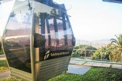 Teleferic Motjuic och barcelona cityscape Arkivfoton