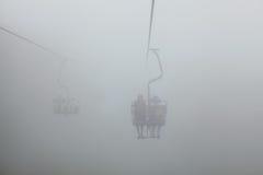 Teleferica nella nebbia Fotografia Stock Libera da Diritti