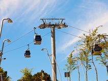 Teleferics (overhead cable cars) over Barcelona, Spain. Cable way at Monjuic hill Royalty Free Stock Images