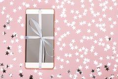 Telefon als Geschenk und Traum Stockbilder
