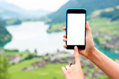 Telefon auf dem Landschaftshintergrund Stockfoto