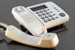 Telefon błyszczący z promieniami zmierzch zdjęcie stock