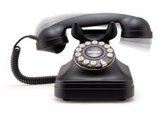Telefon, das weg vom Haken schellt Stockfoto