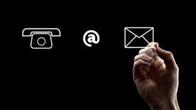 Telefon, an den Zeichen-und Umschlag-Ikonen Stockfotos
