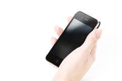 Telefon in der Hand Stockbild