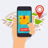 Telefon för hållande mobil för hand smart med mobil app-leveransspårning Arkivfoto