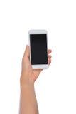 Telefon för hållande mobil för kvinnahand smart med den tomma skärmen isolate Arkivbilder
