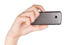 telefon för handholdingmobil Fotografering för Bildbyråer