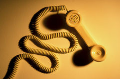 Telefon-Hörer und Netzkabel Stockfotos