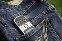 Telefon i cajgi. Obraz Stock