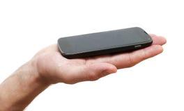 Telefon i handen som isoleras på vit Royaltyfria Foton