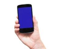 Telefon i handen som isoleras på vit Arkivfoton