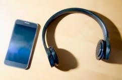 Telefon i hełmofony Obraz Stock