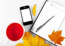 Telefon i Notepad z chwytem Obraz Royalty Free