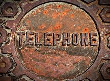 Telefon-Kanaldeckel, Roheisen lizenzfreie stockfotos