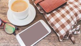 Telefon komórkowy i kawa na drewnianej podłoga Obraz Royalty Free