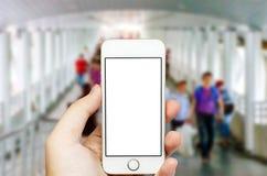 Telefon komórkowy i ludzie spacerów Obraz Stock