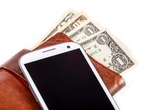 Telefon komórkowy i pieniądze na bielu fotografia stock