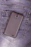Telefon komórkowy na cajgu tle Obraz Stock