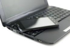 Telefon komórkowy na notatniku Fotografia Stock