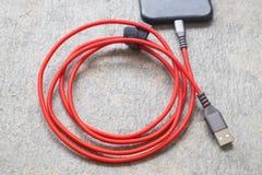 Telefon komórkowy prymka ładowarka Obrazy Royalty Free