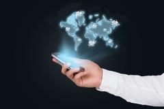 Telefon komórkowy z światową mapą obrazy stock