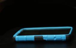 Telefon komórkowy z błękitną skrzynką Zdjęcie Royalty Free