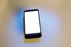 Telefon komórkowy z cieniem obrazy stock