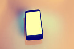 Telefon komórkowy z cieniem fotografia stock