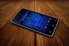 Telefon komórkowy z wekslowych temp ekranem na drewnianym stole Zdjęcia Royalty Free