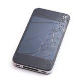 Telefon med den brutna skärmskärmen Royaltyfri Bild