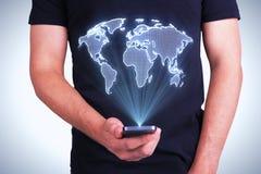 Telefon med den digitala världskartan Royaltyfria Foton