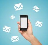 Telefon med e-posttecknet Arkivbild