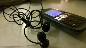 Telefon med hörlurar med mikrofon Royaltyfria Foton