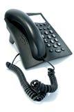 Telefon mit dem gewirbelten Netzkabel Stockbilder
