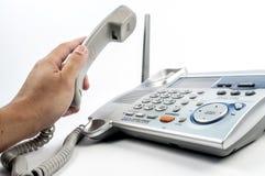 Telefon mit der Hand Lizenzfreies Stockfoto